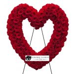 red heart shaped wreath for funeral